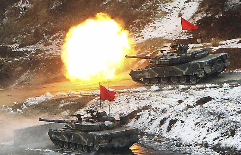A South Korean army K1 tank fires during an annual South Korea-U.S. joint military drill, known as the Key Resolve exercise, at Seungjin Fire Training Field in Pocheon, south of the demilitarized zone (DMZ) that separates the two Koreas since the Korean War, Thursday, March 8, 2012. (AP Photo/Yonhap, Lim Byung-shick) KOREA OUT