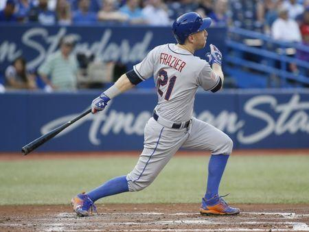 Jul 4, 2018; Toronto, Ontario, CAN; New York Mets third baseman Todd Frazier (21) hits a two run homerun in the fifth inning against the Toronto Blue Jays at Rogers Centre. Mandatory Credit: John E. Sokolowski-USA TODAY Sports