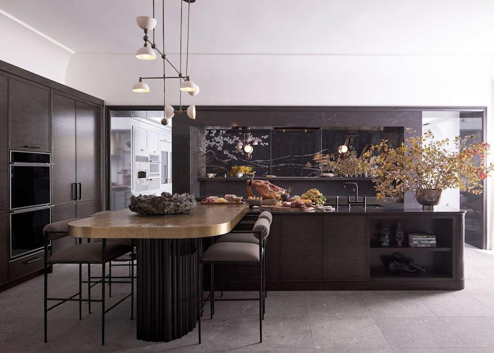 """<p>At the 2020 Kips Bay Decorator Show House Dallas, designed Chad Dorsey wowed his stunning kitchen design that centered on a dramatic backsplash made of a Chinoiserie-painted antique mirror by artist James Mobley on Industry Glass. The painted glass is inset into a <a href=""""https://www.cambriausa.com/"""" rel=""""nofollow noopener"""" target=""""_blank"""" data-ylk=""""slk:Cambria"""" class=""""link rapid-noclick-resp""""><u>Cambria</u></a> stone-clad cased opening.<br></p>"""