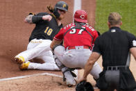 Cincinnati Reds catcher Tyler Stephenson (37) prepares to tag out Pittsburgh Pirates' Ben Gamel (18) who was attempting to score from third on a fielder's choice by Michael Perez during the second inning of a baseball game in Pittsburgh, Thursday, Sept. 16, 2021. (AP Photo/Gene J. Puskar)