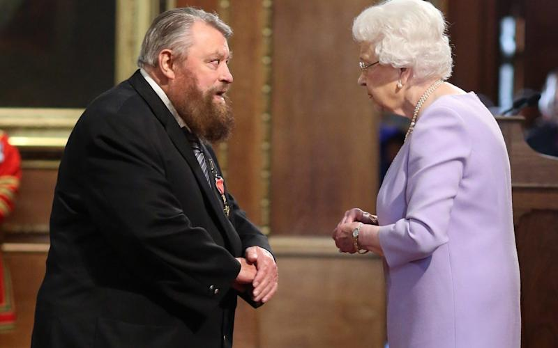 The Queen awards Brian Blessed an OBE -  Jonathan Brady/PA
