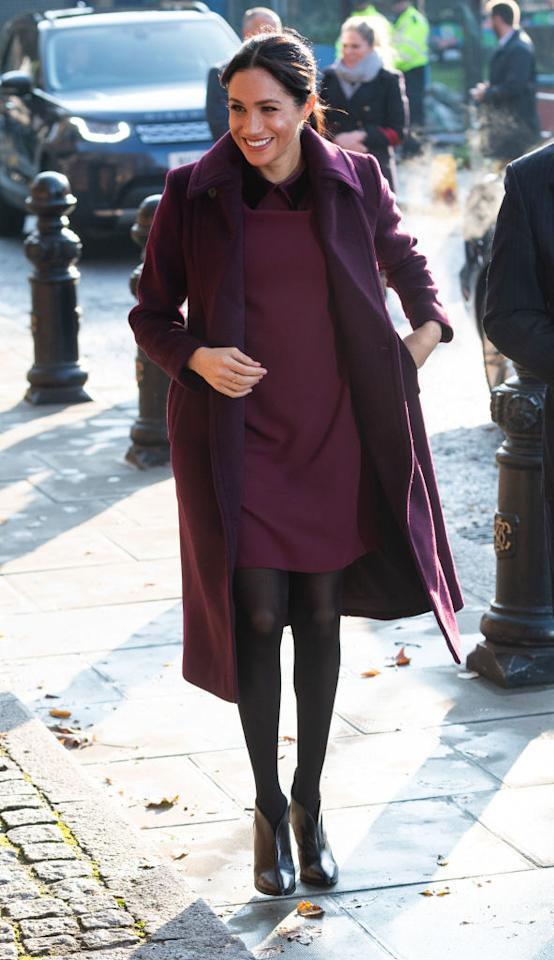 <p>The Duchess of Sussex visited the Hubb Community Kitchen on November 21 to see how proceeds from the Together cookbook are making a difference. For the outing, the royal dressed her bump in a £178 Club Monaco dress with a matching plum-hued coat. <em>[Photo: Getty] </em> </p>