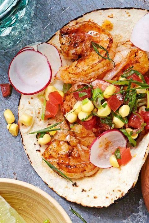 "<p>Citrusy shrimp gets topped with cilantro, limes, salsa, and Cotija cheese, then wrapped in a corn tortilla. Take a bite for an instant taste of Baja.</p><p><em><em><em><a href=""https://www.goodhousekeeping.com/food-recipes/a32700/zesty-shrimp-tacos"" rel=""nofollow noopener"" target=""_blank"" data-ylk=""slk:Get the recipe for Zesty Shrimp Tacos »"" class=""link rapid-noclick-resp"">Get the recipe for Zesty Shrimp Tacos »</a></em></em></em></p>"