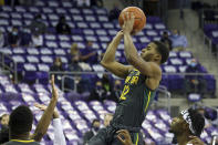 FILE - Baylor guard Jared Butler (12) puts up a shot against TCU during a men's NCAA college basketball game in Fort Worth, Texas, in this Saturday, Jan. 9, 2021, file photo. Butler has made The Associated Press All-America first team, announced Tuesday, March 16, 2021.(AP Photo/ Richard W. Rodriguez, File)