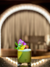 """<p>Those looking for a more wellness-centric take on a spicy margarita will adore this stunning option created by Bonberi's Nicole Berrie in partnership with her new pop-up market at Rosewood Las Ventanas al Paraíso in Los Cabos, Mexico. This recipe is traditionally made with Mezcal del maguey vida but can easily be swapped with a favorite tequila for a more traditional flavor profile. </p><p><strong>Ingredients:</strong><strong><br></strong>50 ml <a href=""""https://tequilafortaleza.com/tequila-fortaleza-reposado/"""" rel=""""nofollow noopener"""" target=""""_blank"""" data-ylk=""""slk:Tequila Fortaleza Reposado"""" class=""""link rapid-noclick-resp"""">Tequila Fortaleza Reposado</a> infused with serrano chilli (or try <a href=""""https://delmaguey.com/"""" rel=""""nofollow noopener"""" target=""""_blank"""" data-ylk=""""slk:Mezcal del Maguey VIDA"""" class=""""link rapid-noclick-resp"""">Mezcal del Maguey VIDA</a> infused with serrano chilli)</p><p>10 ml lime juice</p><p>20 ml fresh green juice (pineapple, celery, cucumber, orange, mango, ginger)</p><p>10 ml aquafaba</p><p>Mango peel and edible flowers, for garnish</p><p><strong>Directions:</strong></p><p>Add ingredients to a cocktail shaker, shake, strain, and serve over ice.</p>"""