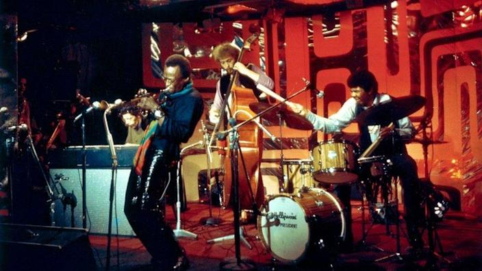 Miles Davis performs on stage with pianist Chick Corea, bassist Dave Holland and drummer Jack Dejohnette for the BBC Jazz Scene TV show, filmed at Ronnie Scott's Jazz Club in London in 1969