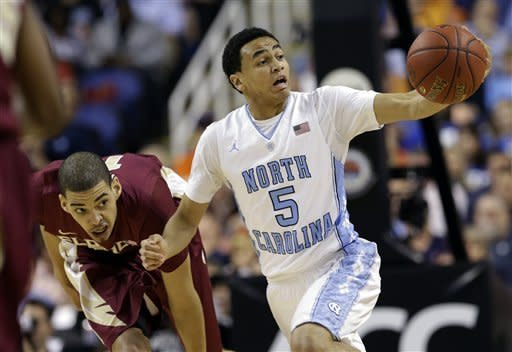 North Carolina's Marcus Paige, right, grabs a loose ball as Florida State's Kiel Turpin, left, defends during the first half of an NCAA college basketball game at the Atlantic Coast Conference men's tournament in Greensboro, N.C., Friday, March 15, 2013. (AP Photo/Gerry Broome)