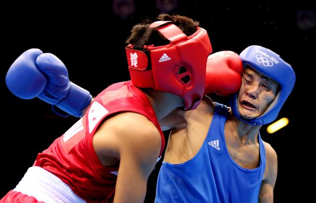 LONDON, ENGLAND - AUGUST 04: Birzhan Zhakypov of Kazakhstan (R) in action with Mark Barriga of Philippines during the Men's Light Fly (46-49kg_ Boxing on Day 8 of the London 2012 Olympic Games at ExCeL on August 4, 2012 in London, England. (Photo by Scott Heavey/Getty Images)