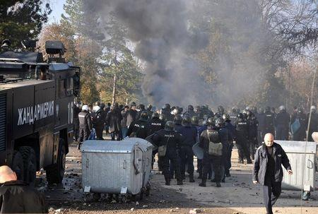Bulgarian riot police are seen inside a refugee center during clashes in the town of Harmanli, Bulgaria, November 24, 2016. REUTERS/Tihmoir Petkov