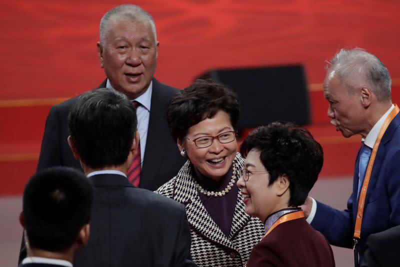 Hong Kong Chief Executive Carrie Lam and Macau's first chief executive Edmund Ho attend a cultural performance in Macau