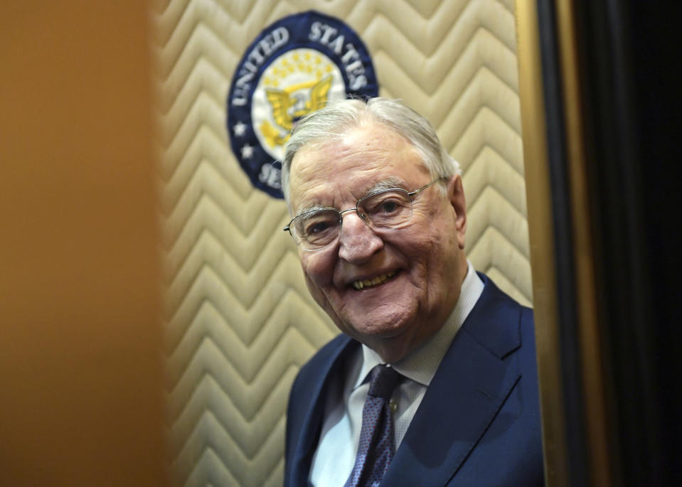 FILE - In this Wednesday, Jan. 3, 2018, file photo, former Vice President Walter Mondale smiles as he gets on an elevator on Capitol Hill in Washington. Mondale, a liberal icon who lost the most lopsided presidential election after bluntly telling voters to expect a tax increase if he won, died Monday, April 19, 2021. He was 93. (AP Photo/Susan Walsh, File)