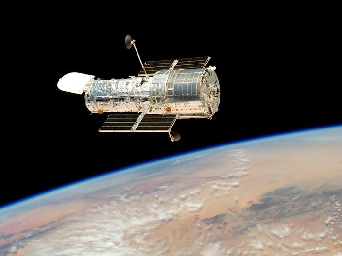 The hubble space telescope orbits above earth