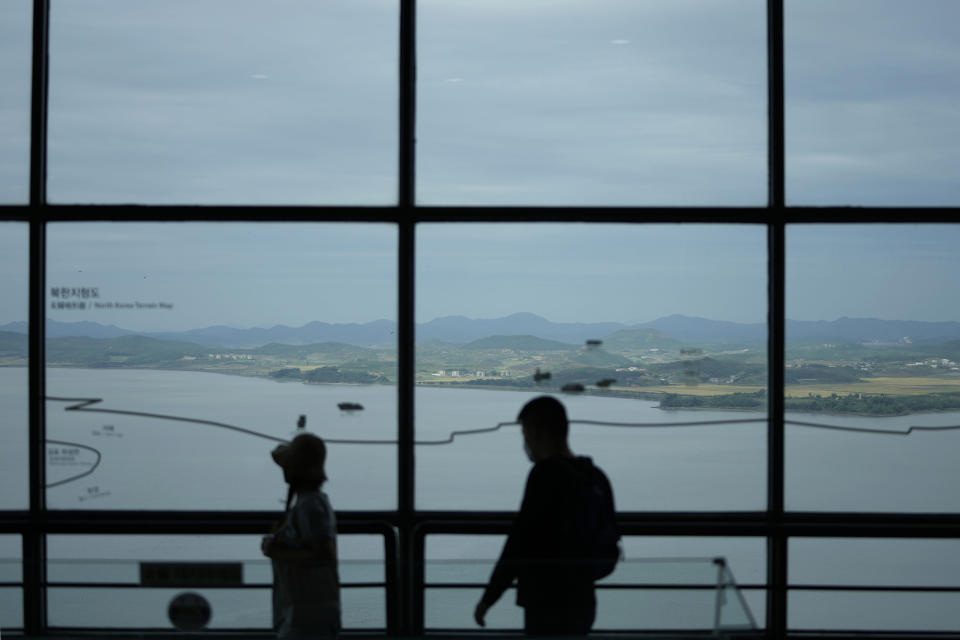 North Korea's Kaepoong town is seen as visitors tour to the unification observatory in Paju, South Korea, Tuesday, Sept. 28, 2021. North Korea fired a short-range missile into the sea early Tuesday, its neighboring countries said, in the latest weapon tests by North Korea that has raised questions about the sincerity of its recent offer for talks with South Korea. (AP Photo/Lee Jin-man)