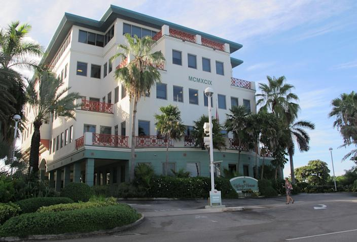 In this Aug. 3, 2012 photo, the Ugland House, the registered office for thousands of global companies, stands in George Town on Grand Cayman Island. The Cayman Islands have lost some of their allure by abruptly proposing what amounts to an income tax on expatriate workers who have helped build the territory into one of the most famous or, for some people, notorious offshore banking centers that have tax advantages for foreign investment operations. (AP Photo/David McFadden)