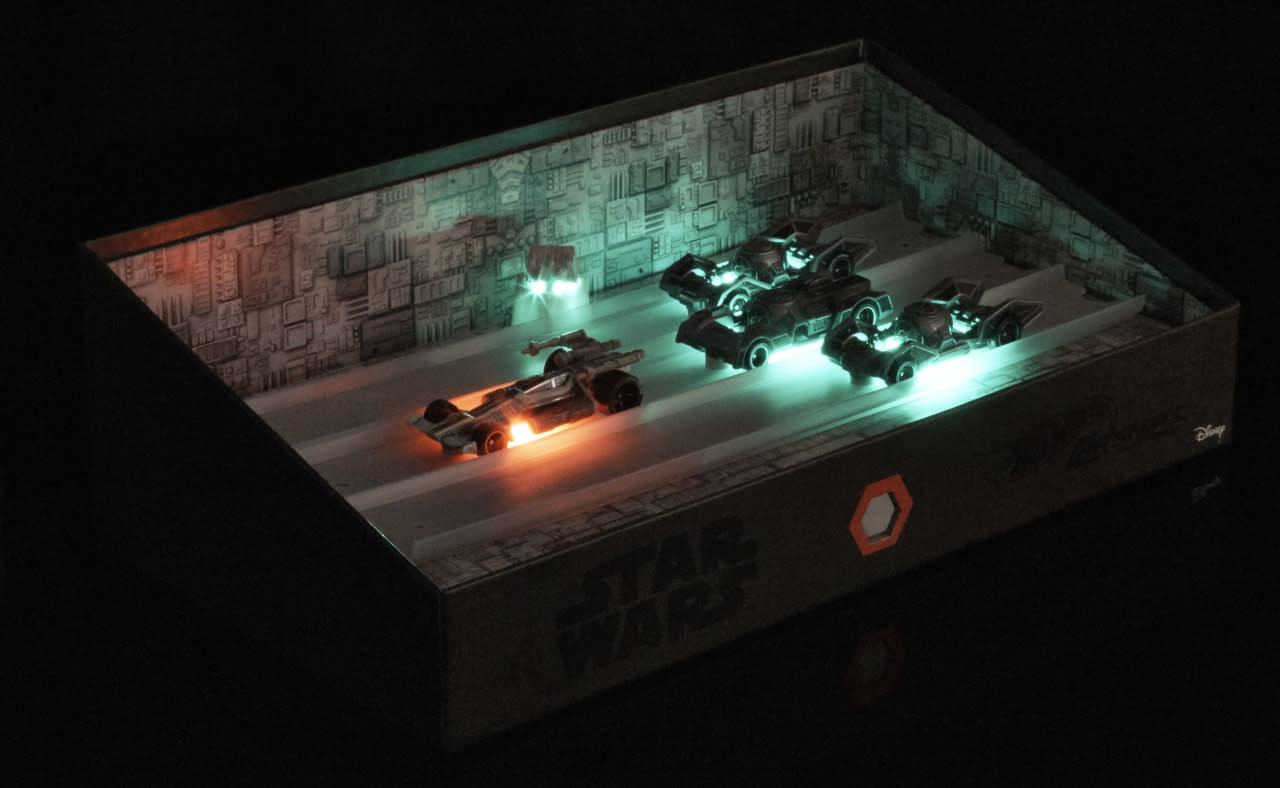 <p>A push of the button illuminates the vehicles and unleashes sound and light effects replicating the laser blasts of the original <i>Star Wars</i>.</p><p><br /></p>