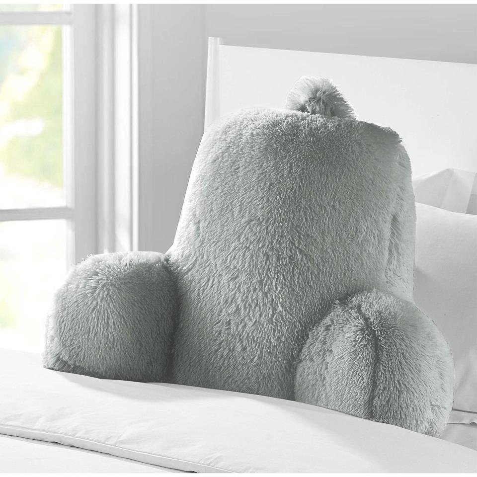 "<p>Late-night readings call for resting on this <a href=""https://www.popsugar.com/buy/Mainstays-Long-Hair-Faux-Fur-Backrest-Pillow-476367?p_name=Mainstays%20Long%20Hair%20Faux%20Fur%20Backrest%20Pillow&retailer=walmart.com&pid=476367&price=17&evar1=savvy%3Aus&evar9=46463248&evar98=https%3A%2F%2Fwww.popsugar.com%2Fsmart-living%2Fphoto-gallery%2F46463248%2Fimage%2F46463249%2FMainstays-Long-Hair-Faux-Fur-Backrest-Pillow&list1=shopping%2Ccollege%2Cwalmart%2Cback%20to%20school%20shopping%2Cdorms&prop13=api&pdata=1"" rel=""nofollow"" data-shoppable-link=""1"" target=""_blank"" class=""ga-track"" data-ga-category=""Related"" data-ga-label=""https://www.walmart.com/ip/Mainstays-Long-Hair-Faux-Fur-Backrest-Pillow-Gray/173605737?selected=true"" data-ga-action=""In-Line Links"">Mainstays Long Hair Faux Fur Backrest Pillow</a> ($17, originallly $20).</p>"