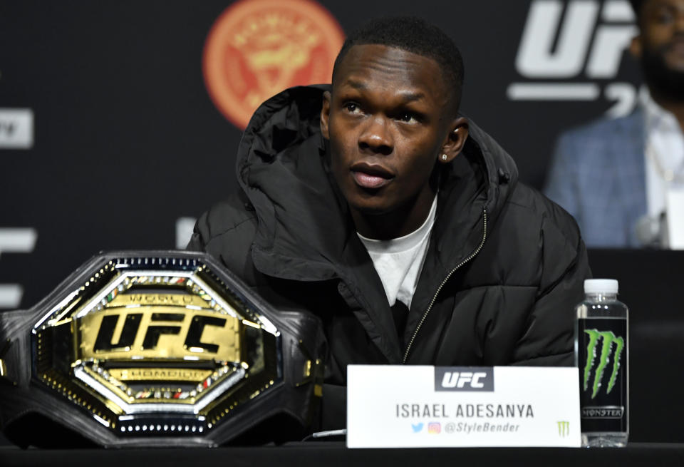 LAS VEGAS, NEVADA - MARCH 04: Israel Adesanya of Nigeria interacts with media at UFC APEX on March 04, 2021 in Las Vegas, Nevada. (Photo by Jeff Bottari/Zuffa LLC)