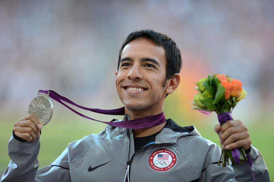 """US silver medalist U.S. runner <a href=""""http://sports.yahoo.com/olympics/track-field/leonel-manzano-1130468/"""" data-ylk=""""slk:Leonel Manzano"""" class=""""link rapid-noclick-resp"""">Leonel Manzano</a> celebrates on the podium of the men's 1500m at the athletics event of the London 2012 Olympic Games on August 8, 2012 in London. (JOHANNES EISELE/AFP/Getty Images)"""