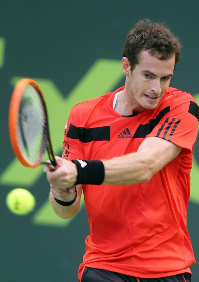 Andy Murray of Great Britain returns the ball to Florian Mayer of Germany during the Qatar ATP Open Tennis tournament in Doha, Qatar, Wednesday, Jan. 1, 2014. (AP Photo/Osama Faisal)