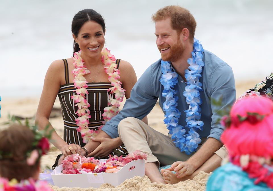 SYDNEY, AUSTRALIA - OCTOBER 19:  Prince Harry, Duke of Sussex and Meghan, Duchess of Sussex talk to members of OneWave, an awareness group for mental health and wellbeing at South Bondi Beach on October 19, 2018 in Sydney, Australia. The Duke and Duchess of Sussex are on their official 16-day Autumn tour visiting cities in Australia, Fiji, Tonga and New Zealand.  (Photo by Chris Jackson-Pool/Getty Images)