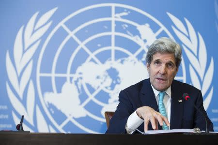 U.S. Secretary of State Kerry gestures during a news conference after he delivered remarks to the United Nations Human Rights Council in Geneva