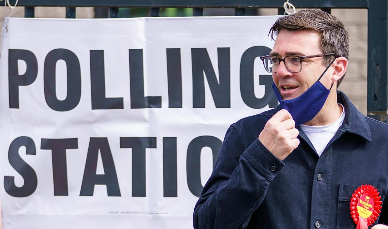 Mayor of Greater Manchester Andy Burnham leaves Golborne Library, Golborne, Warrington, after casting his vote in the Manchester Mayoral election. Picture date: Thursday May 6, 2021.
