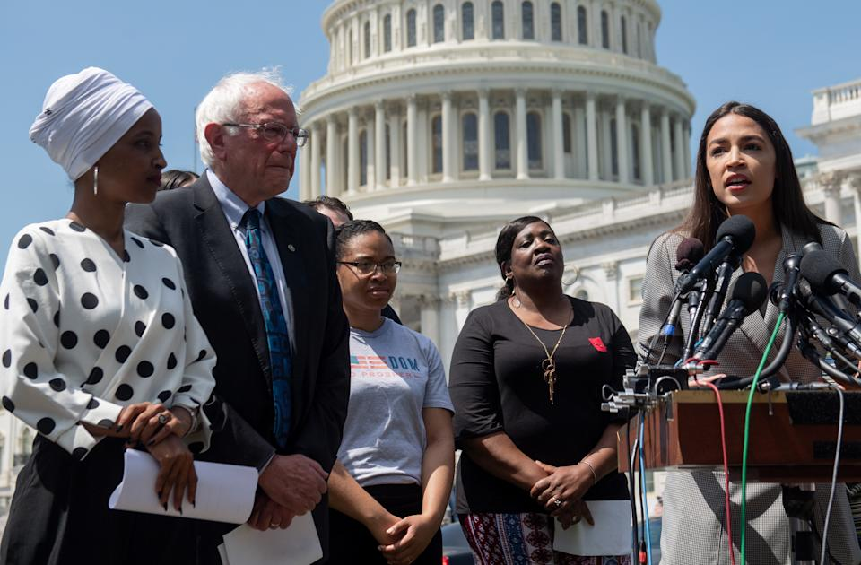 Representative Alexandria Ocasio-Cortez (2nd R), Democrat of New York, speaks alongside US Senator Bernie Sanders (2nd L), Independent of Vermont, and Representative Ilhan Omar (L), Democrat of Minnesota, during a press conference to introduce college affordability legislation outside the US Capitol in Washington, DC, June 24, 2019. (Photo by SAUL LOEB / AFP)        (Photo credit should read SAUL LOEB/AFP via Getty Images)