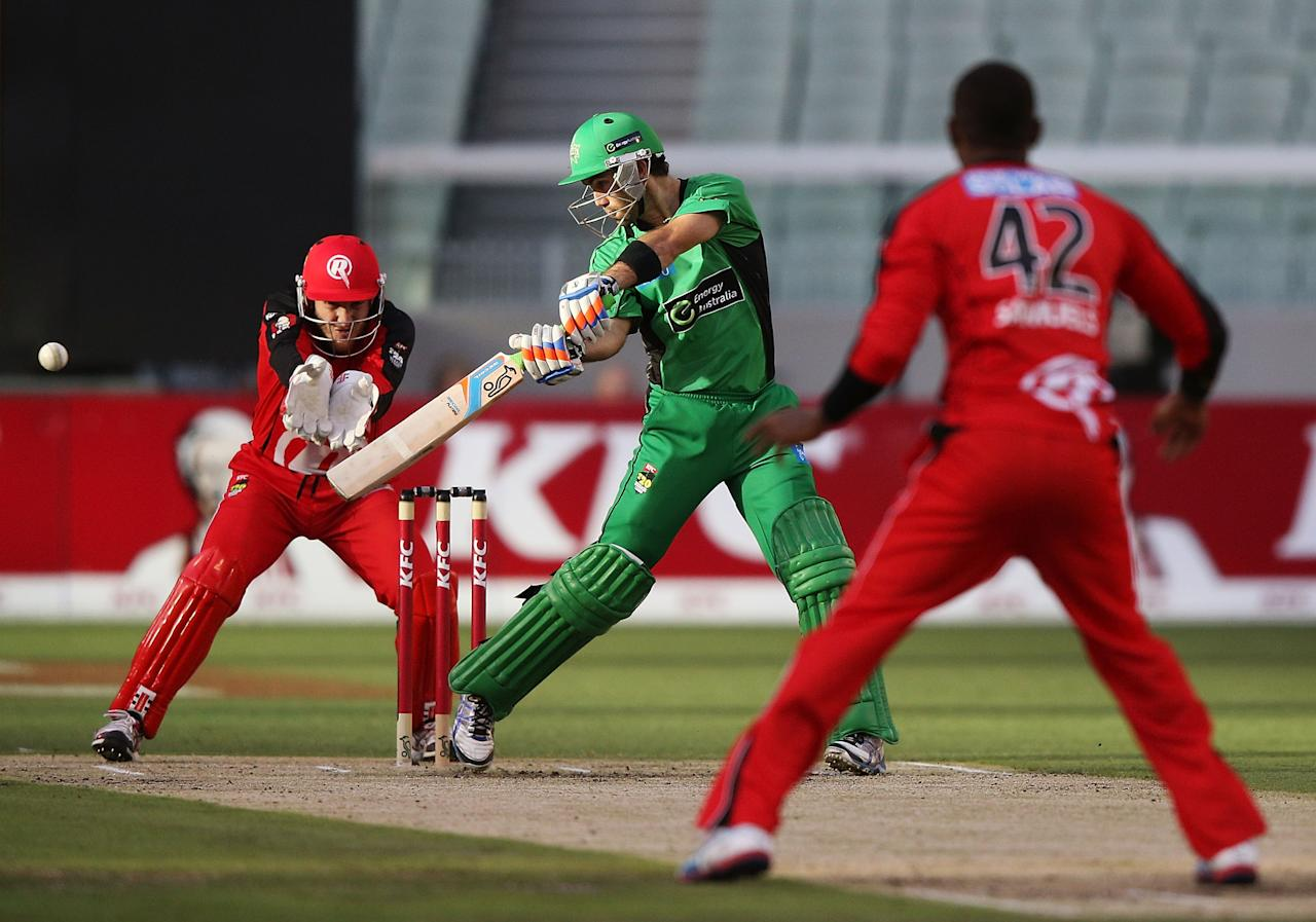 MELBOURNE, AUSTRALIA - JANUARY 06:  Glenn Maxwell of the Melbourne Stars hits the ball but gets caught off the bowling of Marlon Samuels of the Melbourne Renegades during the Big Bash League match between the Melbourne Stars and the Melbourne Renegades at Melbourne Cricket Ground on January 6, 2013 in Melbourne, Australia.  (Photo by Michael Dodge/Getty Images)