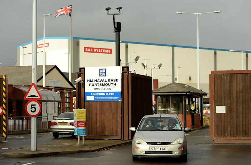 A general view of Unicorn Gate at HMS Nelson Portsmouth, England, Wednesday, Nov. 6, 2013, home to BAE Systems who are to axe jobs across its naval ships business and end shipbuilding at one of the country's most historic yards, in Portsmouth. British politicians are expressing alarm over the possibility that hundreds of jobs could be cut at three shipyards. Defense contractor BAE has been studying the fate of shipyards at Portsmouth in England and Govan and Scotstoun in Scotland. The company did not comment on reports it would stop shipbuilding at Portsmouth and cut jobs at the other two. (AP Photo/Andrew Matthews, PA) UNITED KINGDOM OUT