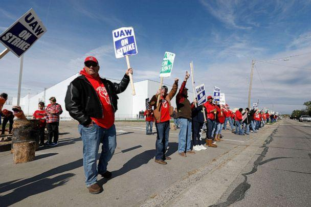 PHOTO: United Auto Workers union members and their families picket at the General Motors Flint Assembly plant on Solidarity Sunday on Oct. 13, 2019, in Flint, Michigan. (Bill Pugliano/Getty Images)