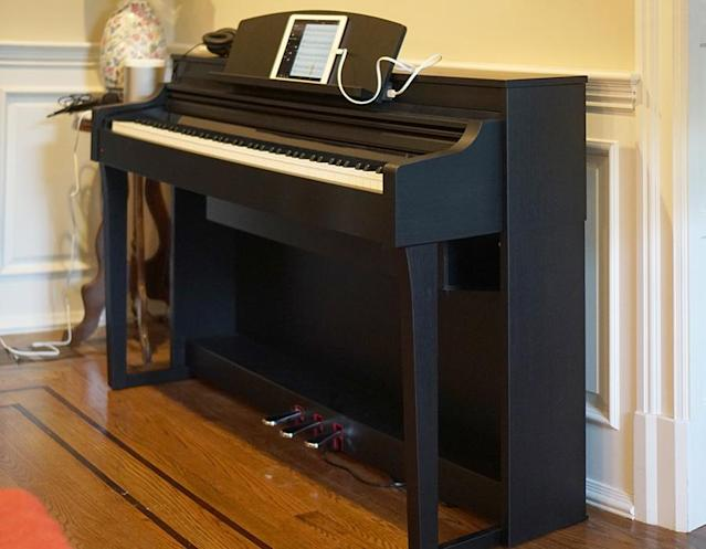 The Yamaha Clavinova CSP looks and sounds like a nice upright piano.