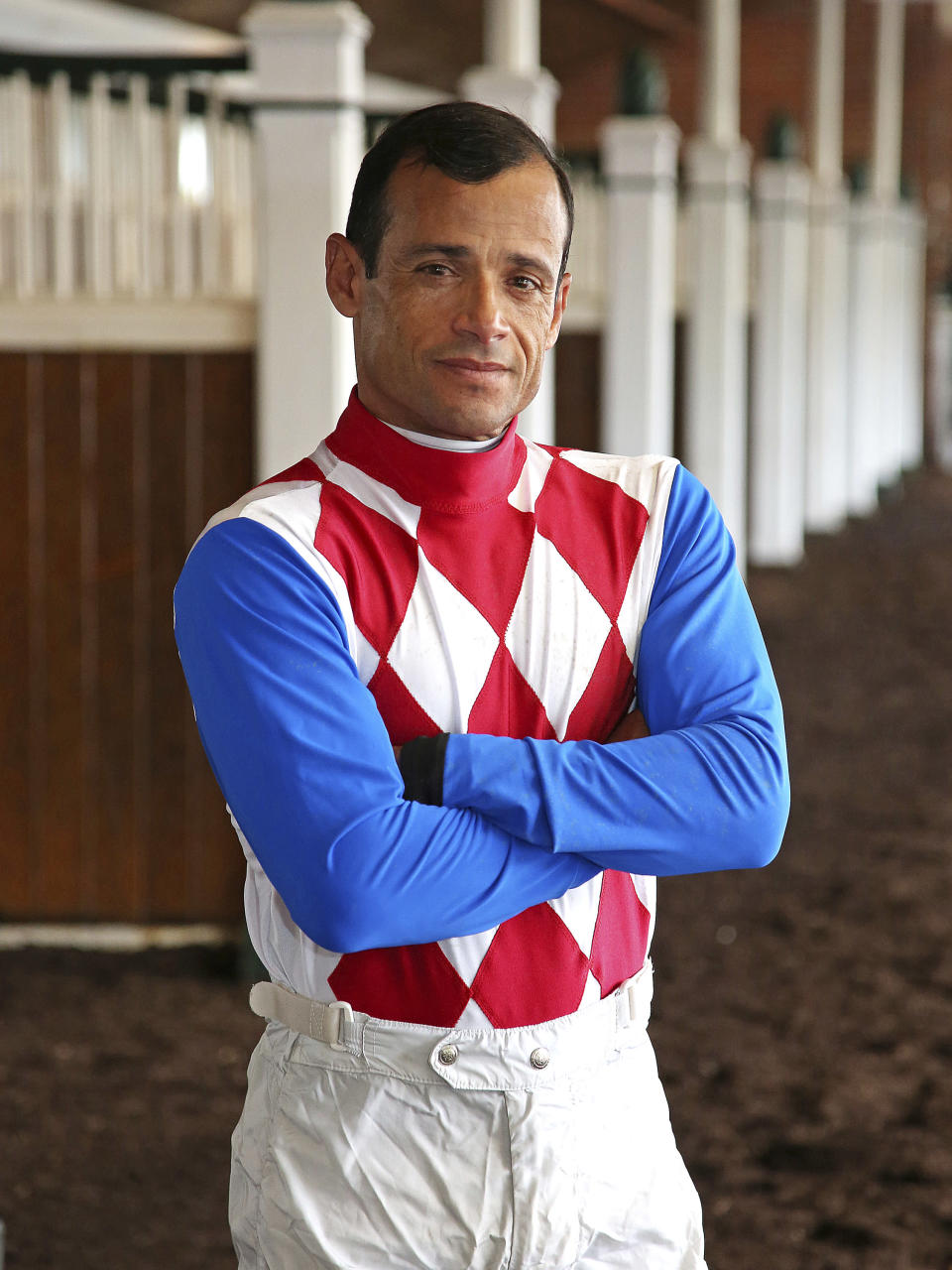 This photo provided by Equi-Photo shows jockey Jose Ferrer posed at Monmouth Park in Oceanport, N.J., Tuesday, June 15, 2021. Just look around the world of sports and athletes are winning events at older ages. Phil Mickelson won the PGA earlier this year at almost 51, and Tom Brady won another Super Bowl _ with the Tampa Bay Buccaneers this time _ at more than 43 in February. Jockey Jose Ferrer isn't doing anything as grandiose. He's just leading all jockeys in wins at Monmouth Park in New Jersey after 10 days of racing with 16 wins in 56 mounts. (Bill Denver/Equi-Photo via AP)