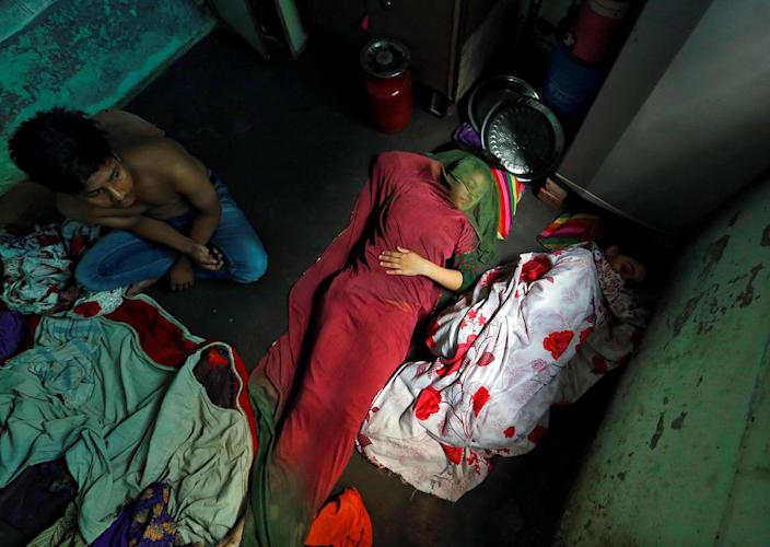 <p>A family from the Qureshi community rests behind a butcher shop, ordered to close, following regulations imposed by newly elected Uttar Pradesh State Chief Minister, Yogi Adityanath, in Lucknow, India April 6, 2017. (Photo: Cathal McNaughton/Reuters) </p>