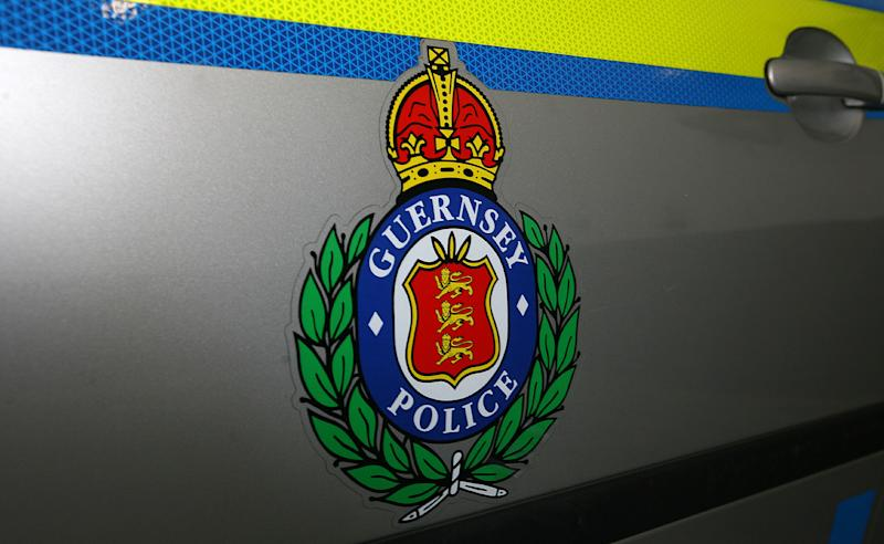 A Guernsey Police logo on a police car, Guernsey, Channel Islands.