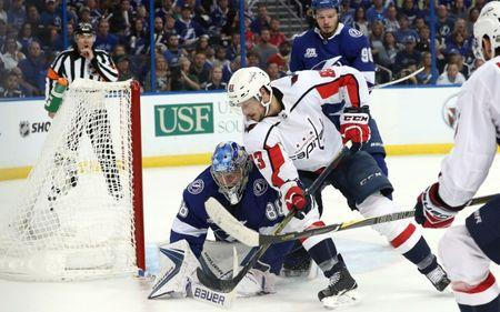 May 19, 2018; Tampa, FL, USA; Tampa Bay Lightning goaltender Andrei Vasilevskiy (88) makes a save against Washington Capitals center Jay Beagle (83) during the second period in game five of the Eastern Conference Final in the 2018 Stanley Cup Playoffs at Amalie Arena. Mandatory Credit: Kim Klement-USA TODAY Sports