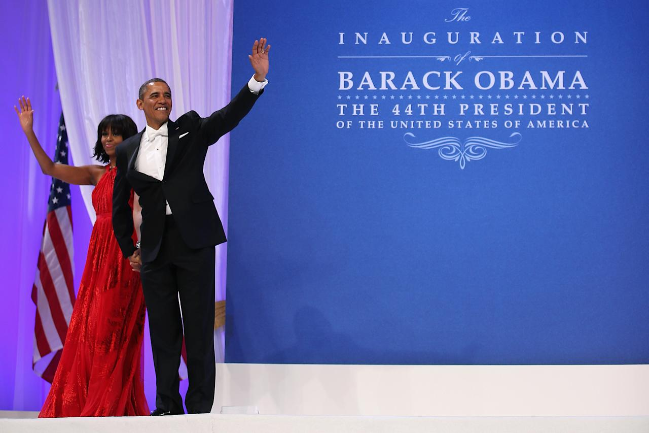 WASHINGTON, DC - JANUARY 21:  U.S. President Barack Obama and first lady Michelle Obama wave goodbye after attending the Comander-in-Chief's Inaugural Ball at the Walter Washington Convention Center January 21, 2013 in Washington, DC. Obama was sworn-in for his second term of office earlier in the day.  (Photo by Chip Somodevilla/Getty Images)