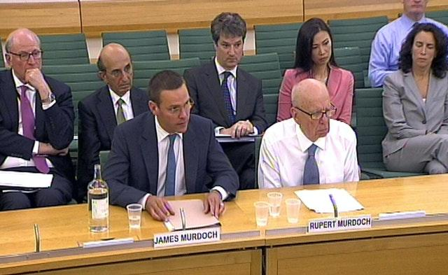 James and Rupert Murdoch before Commons comittee