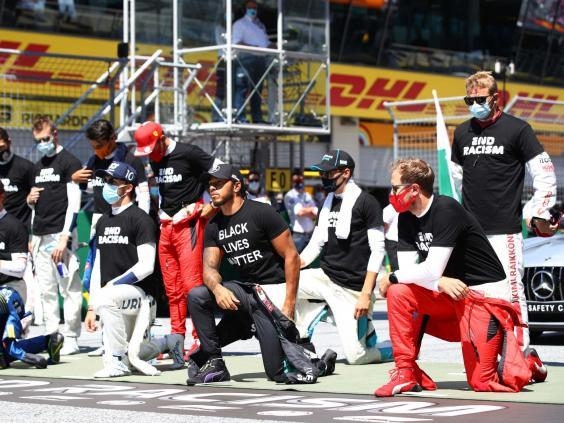 Hamilton has taken a knee before each of the three races this season (Getty)