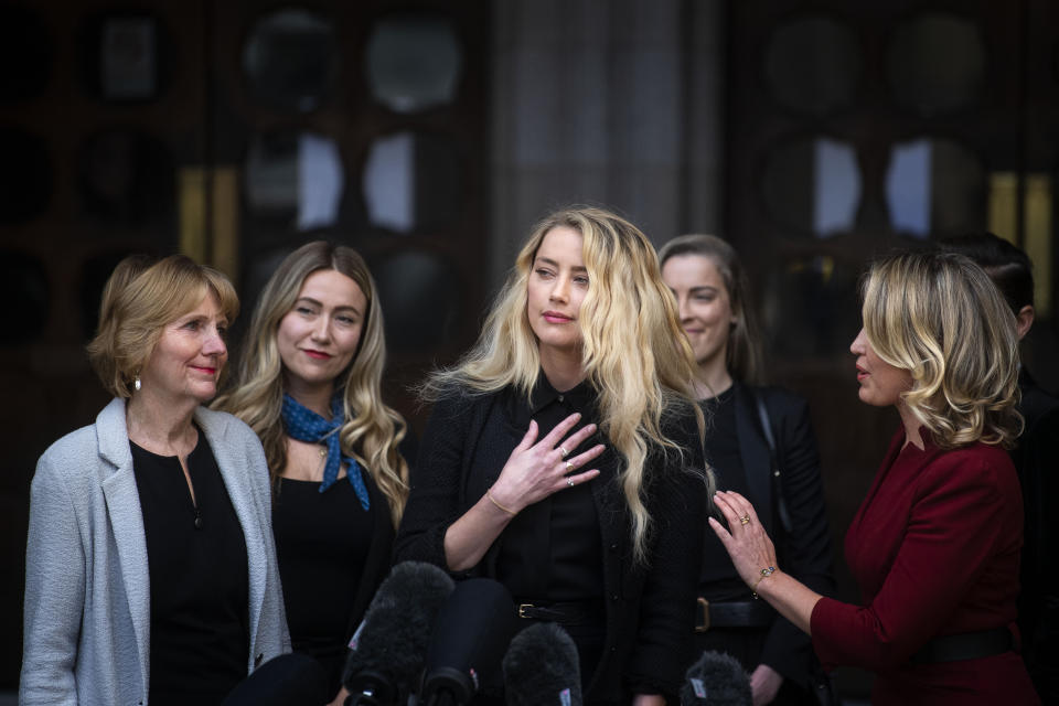 Actress Amber Heard, alongside her sister Whitney Henriquez (second right) and lawyer Jen Robinson (right), as she gives a statement outside the High Court in London on the final day of hearings in Johnny Depp's libel case against the publishers of The Sun and its executive editor, Dan Wootton. After almost three weeks, the biggest English libel trial of the 21st century is drawing to a close, as Mr Depp's lawyers are making closing submissions to Mr Justice Nicol. (Photo by Victoria Jones/PA Images via Getty Images)