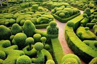 """<p>Overlooking the Dordogne Valley on a rocky cliff, the Hanging Gardens of Marqueyssac contains over 150,00 boxwood trees meticulously laid and manicured to create mesmerizing patterns. The originals plan for the garden at the 17th-century chateau have been attributed to a student of royal landscape architect André Le Nôtre. However, it's believed that Julien de Cervel began developing the verdant labyrinth as we know it today after purchasing the property in the 1860s. </p><p>After much restoration and the addition of a cascading waterfall from the belvedere, the greenspace officially opened to the public in 1996 and have since been named of the """"Notable Gardens of France"""" by the Committee of Parks and Gardens of the French Ministry of Culture. <br></p>"""