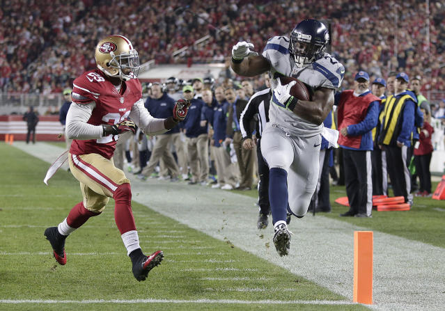 FILE - In this Nov. 27, 2014, file photo, Seattle Seahawks running back Robert Turbin (22) scores on a 13-yard touchdown reception in front of San Francisco 49ers defensive back Chris Culliver (29) during the first quarter of an NFL football game in Santa Clara, Calif. Turbin posted a picture from the Seahawks locker room on social media late Monday, Dec. 23, 2019. There was no confirmation from the team that Turbin has signed, but he had been in for a workout with the team last week. (AP Photo/Marcio Jose Sanchez, File)
