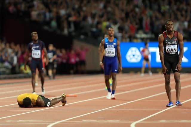 Jamaica's Usain Bolt lies on the ground after falling in his final race at the 2017 World Championships. (Adam Davy/PA)