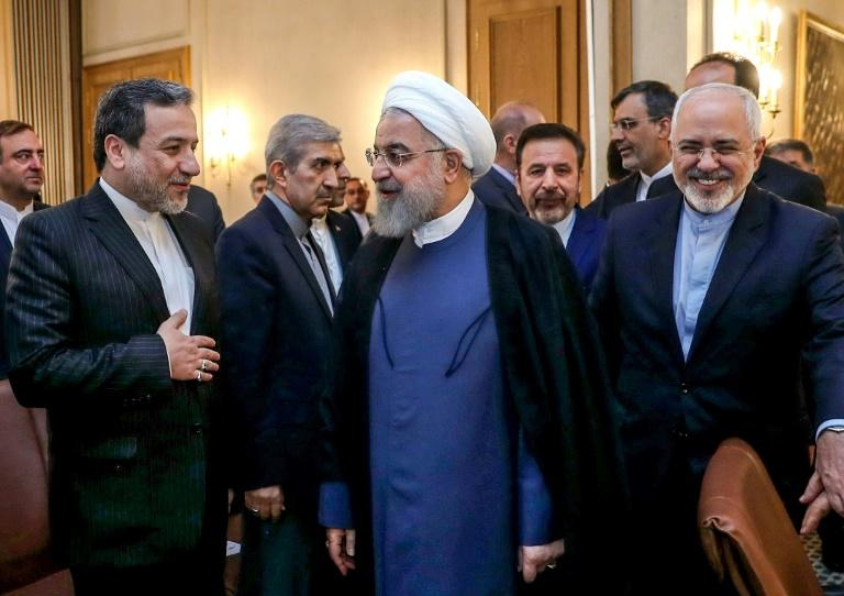 Iran's President Hassan Rouhani (C) warns his country could shut down the strategic Strait of Hormuz