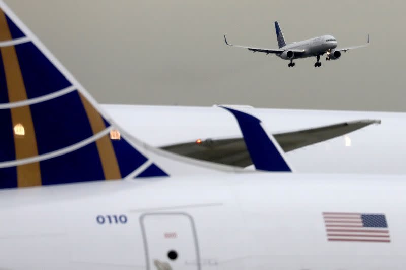 FILE PHOTO: A United Airlines passenger jet lands at Newark Liberty International Airport