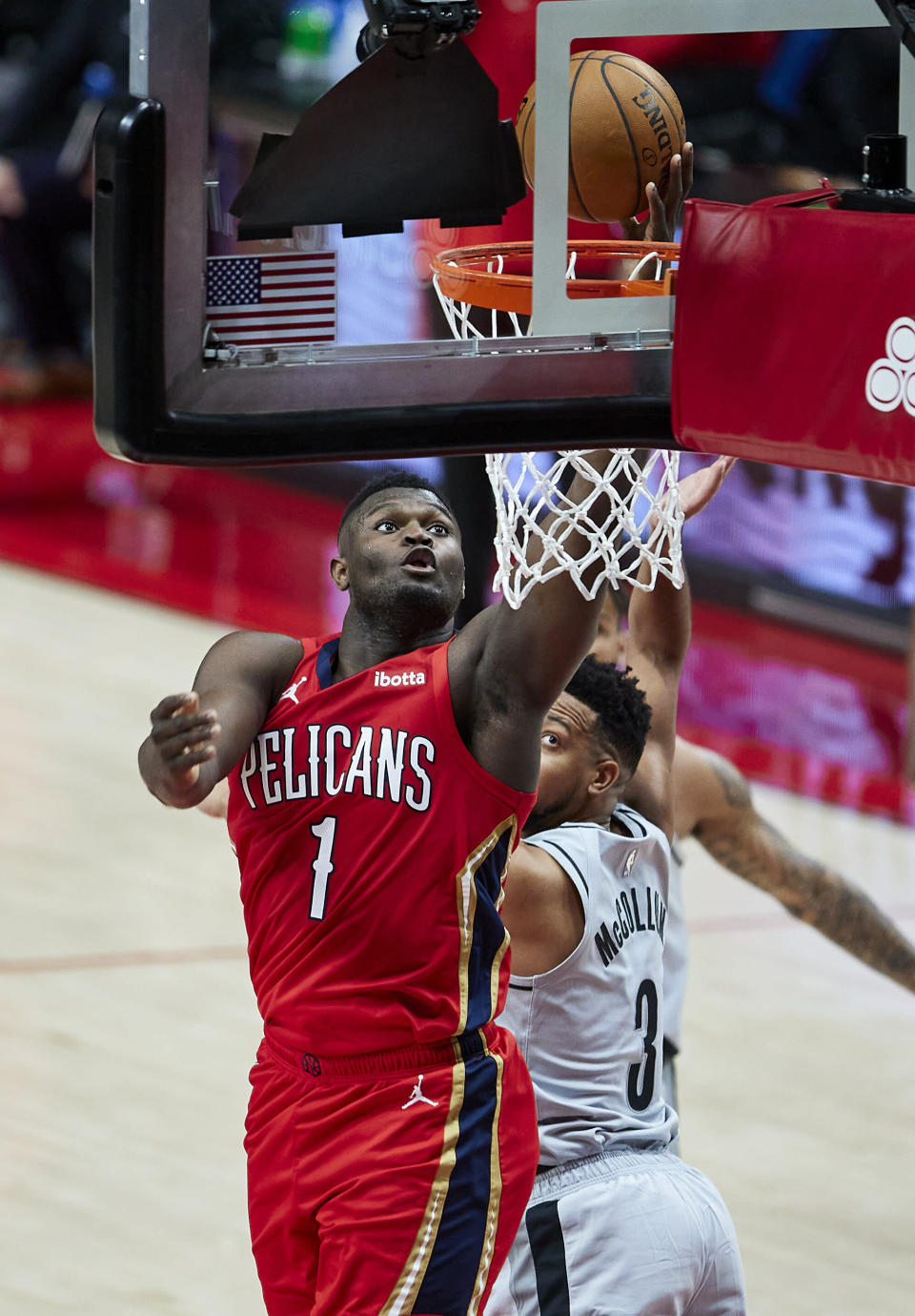 New Orleans Pelicans forward Zion Williamson, left, shoots in front of Portland Trail Blazers guard CJ McCollum during the first half of an NBA basketball game in Portland, Ore., Tuesday, March 16, 2021. (AP Photo/Craig Mitchelldyer)