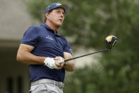Phil Mickelson watches his tee shot on the 18th hole during the third round of the World Golf Championship-FedEx St. Jude Invitational Saturday, Aug. 1, 2020, in Memphis, Tenn. (AP Photo/Mark Humphrey)