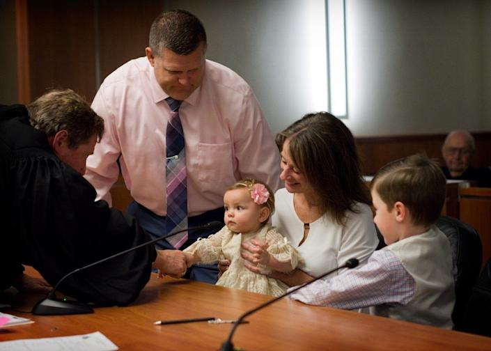 """""""I met this family the day of their adoption. They adopted their son and were now adding a little girl. The grandparents were also present at the adoption. The judge was so sweet. He took his time and made sure to get to know the family."""" -- Aimee Butier"""