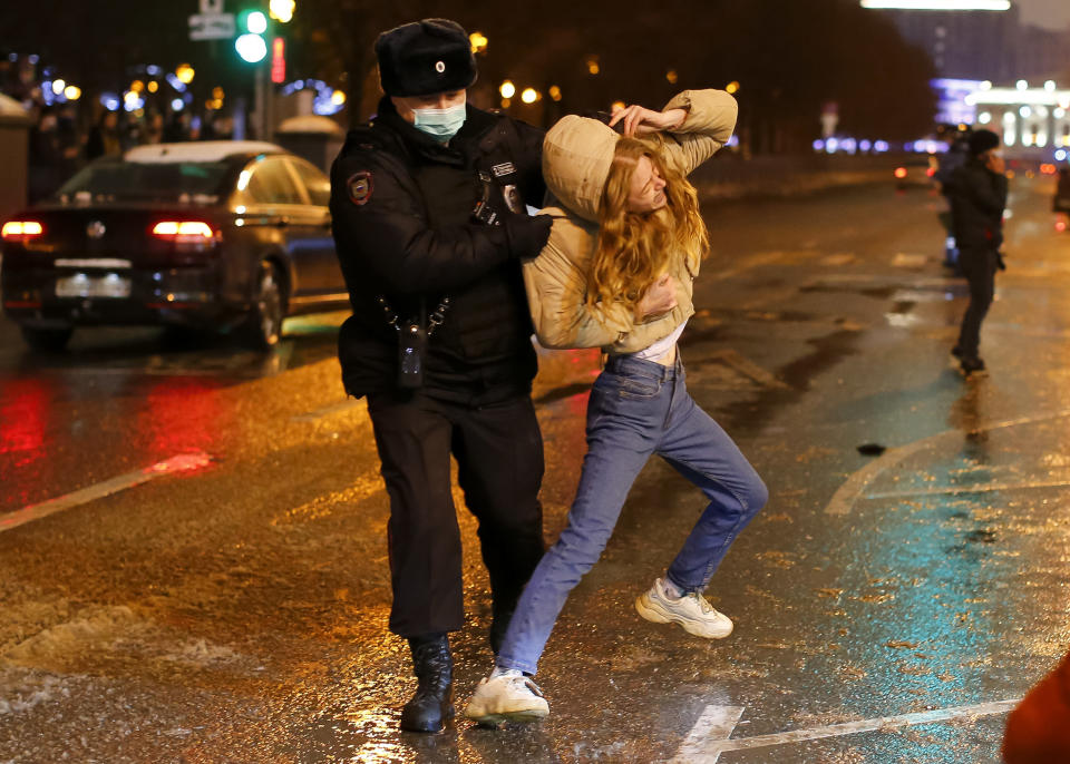 FILE - In this Jan. 23, 2021, file photo, a police officer detains a young woman during a protest against the jailing of opposition leader Alexei Navalny in Pushkin square in Moscow, Russia. Allies of Navalny are calling for new protests next weekend to demand his release, following a wave of demonstrations across the country that brought out tens of thousands in a defiant challenge to President Vladimir Putin. (AP Photo/Alexander Zemlianichenko, File)