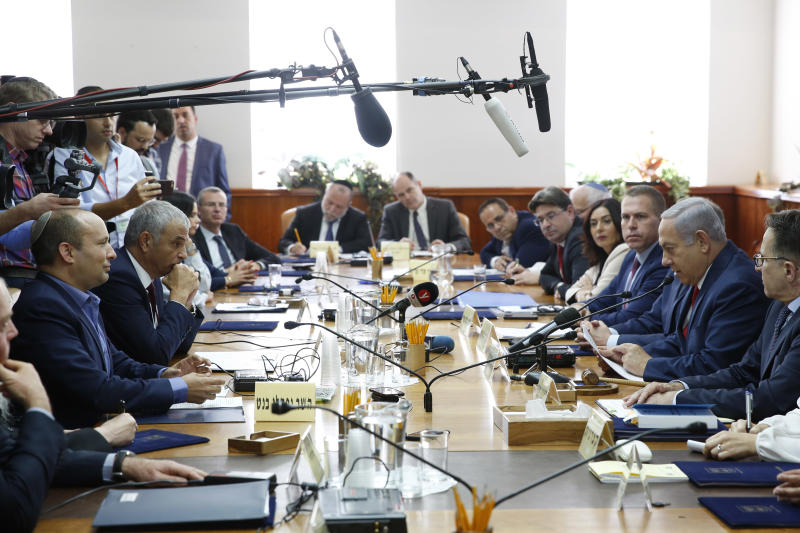 Israeli Prime Minister Benjamin Netanyahu chairs the weekly cabinet meeting at the prime minister's office in Jerusalem, Sunday, Nov. 18, 2018. (Abir Sultan/Pool via AP)