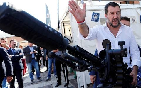Italian Interior Minister Salvini has been accused by opponents of burnishing his 'tough guy' image again - here he poses in October 2018 with a sniper rifle during a visit to celebrate the anniversary of the Central Security Operations Service (NOCS), a SWAT team of the Polizia di Stato in Rome - Credit: Reuters
